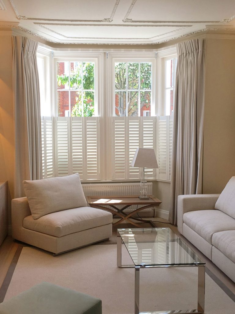 https://www.londonshades.co.uk/wp-content/uploads/2020/04/1-pinch-pleat-curtains-and-half-shutters.jpg